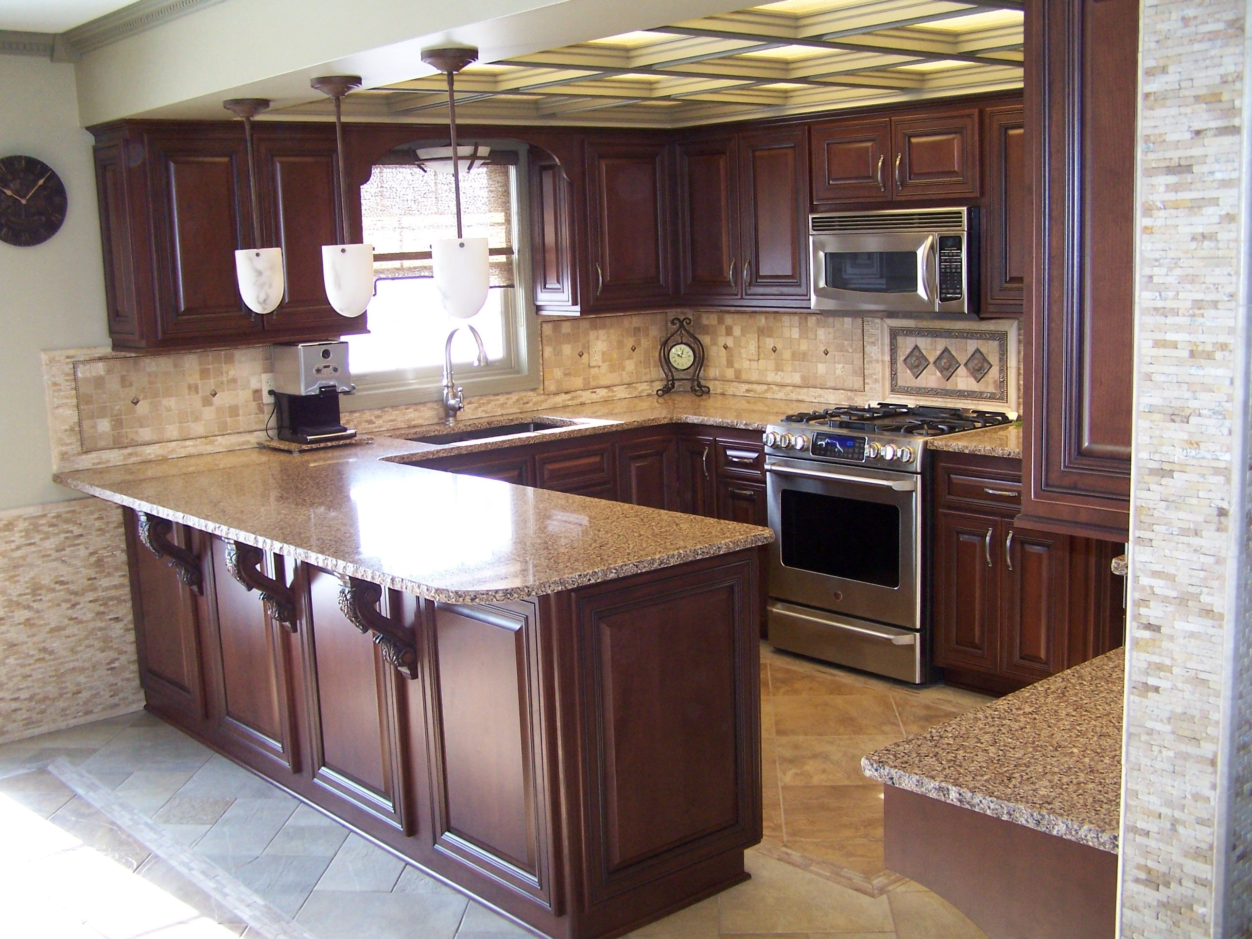 love the color of the cabinets and backsplash idea our tile and color scheme maybe remodel ideas - Newly Remodeled Kitchens
