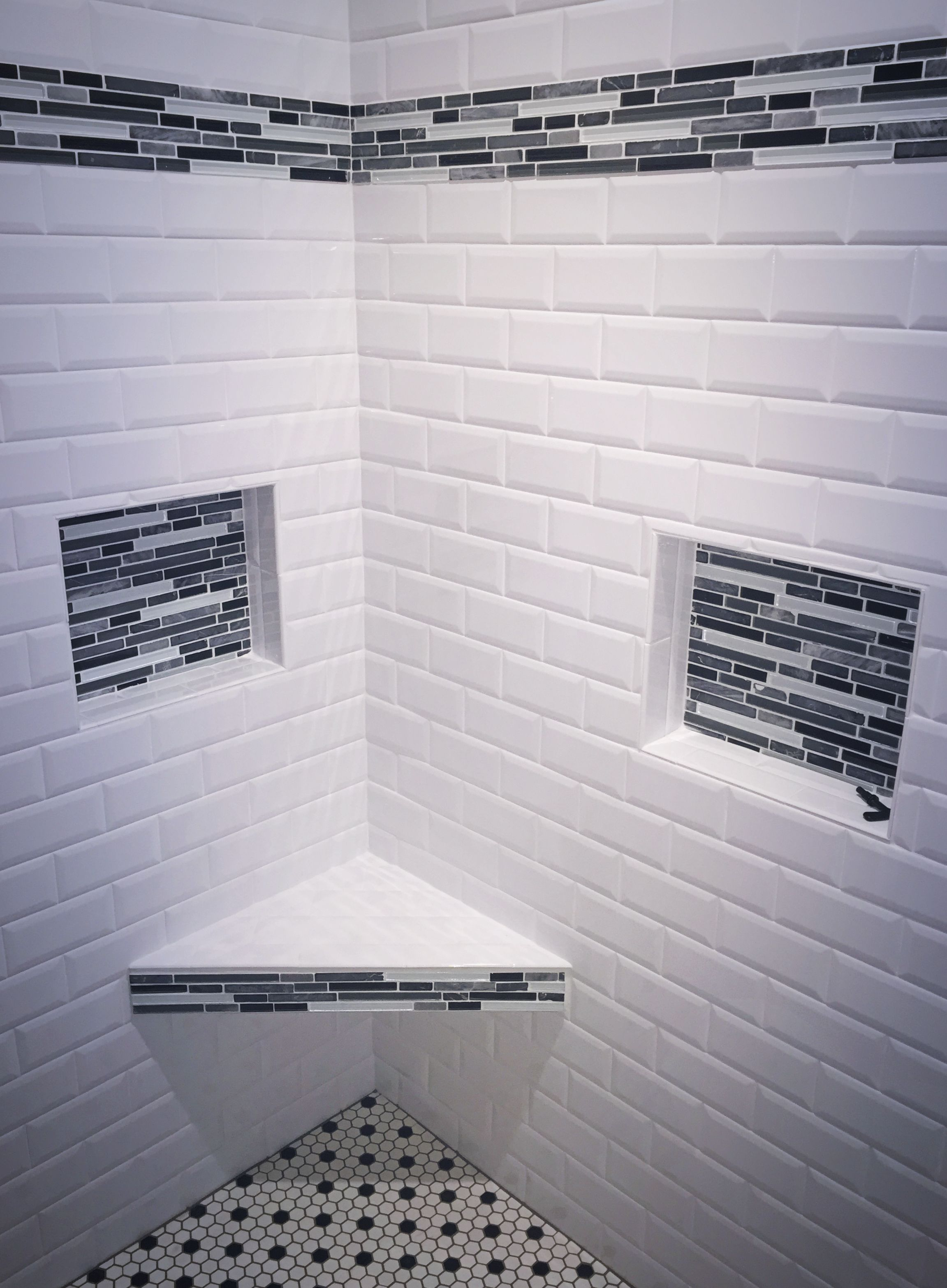 Remodeled shower. Walls done in on-trend white subway tile ...