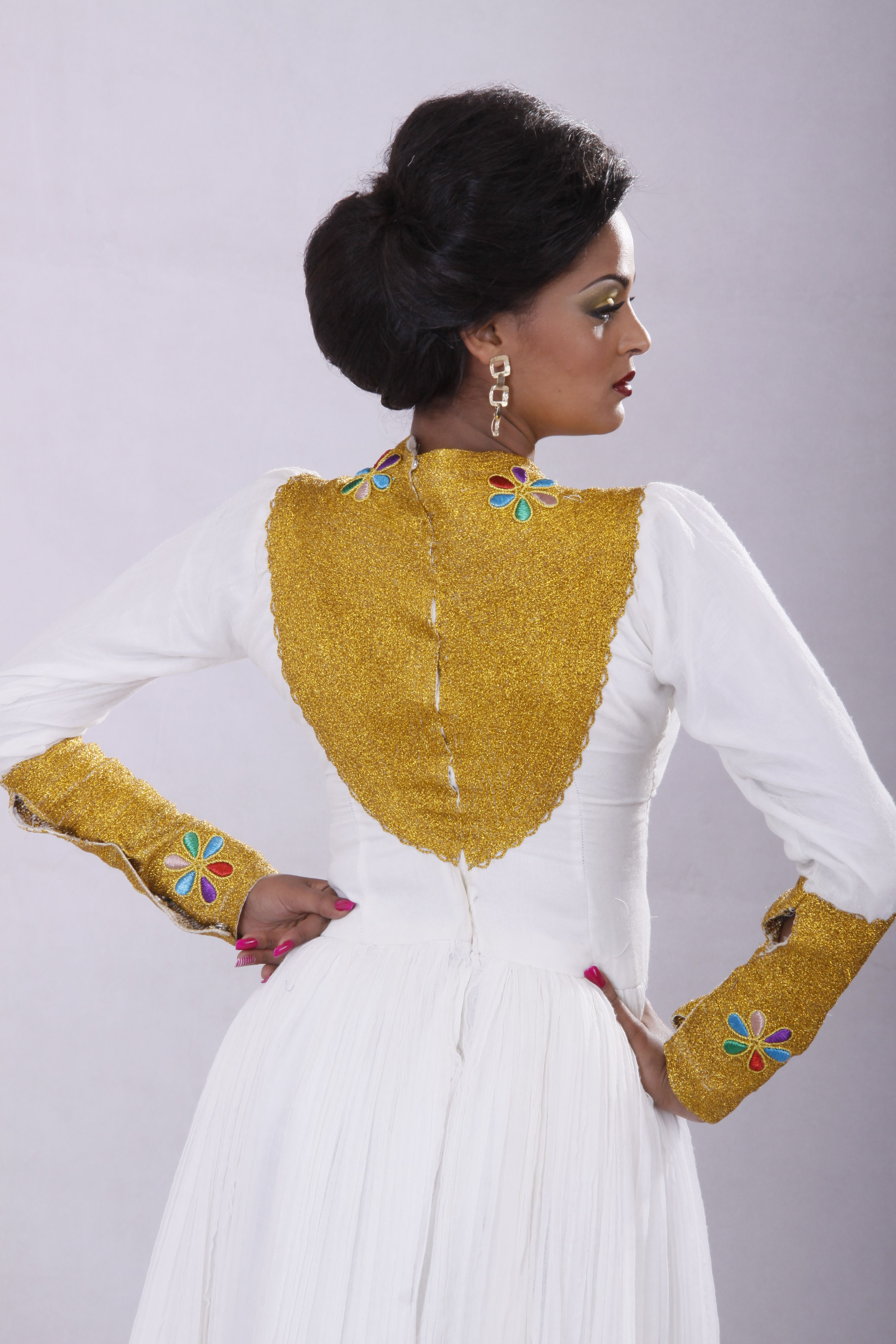 Sneak peak from featured designer tsehaye mehari bella for Ethiopian traditional wedding dress designer