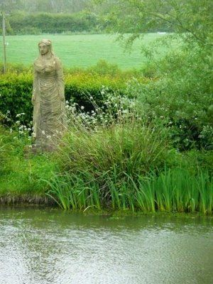 Lady of The Lake sculpture by Vanessa Bell Charleston Farmhouse garden