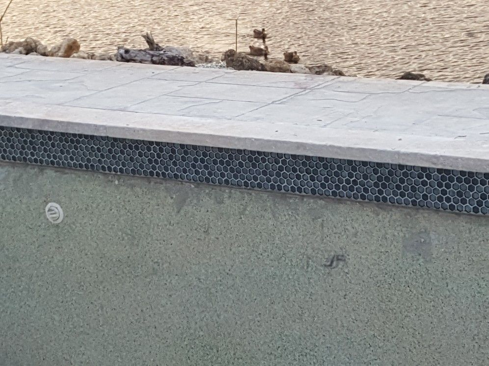 Pool Coping And Waterline Tile Is In For The Pool Deck We Re Going To Be Using 3 6 Silver Tumbled Travertine Pool Decking Travertine Pool Building A Pool