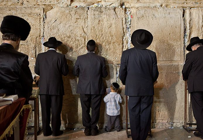 Jerusalem: A young Jewish boy joins his father in prayer at the Western Wall