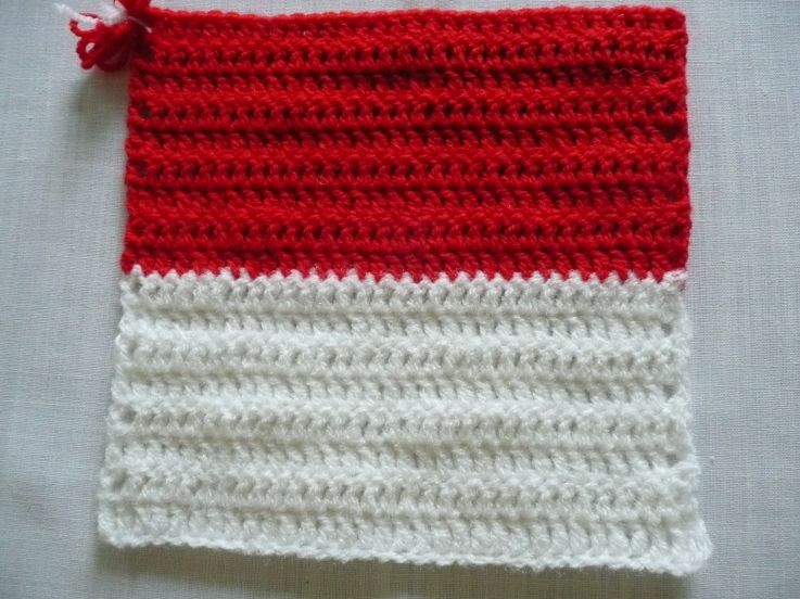 Flag of Monaco - Karla B. To learn more about our organization go to www.knit-a-square.com To meet our members and see more of our knitting and crochet go to http://forum.knit-a-square.com/