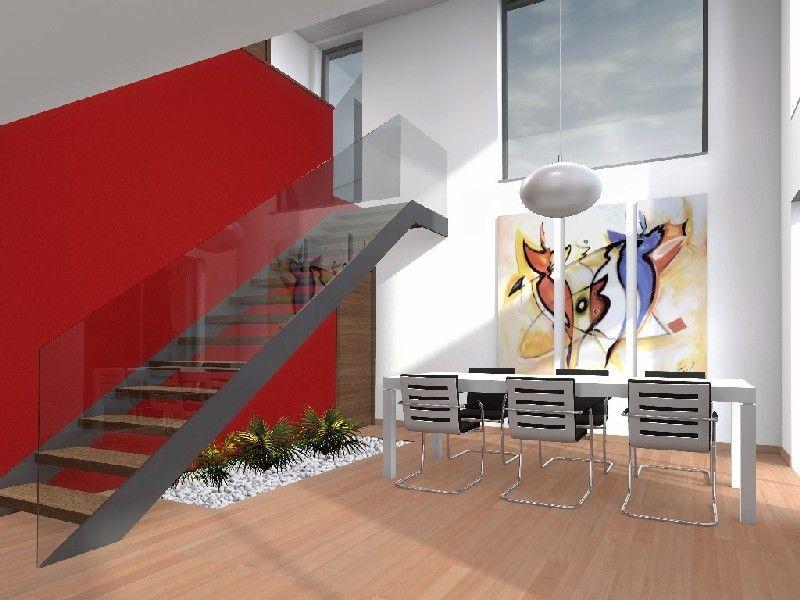 Interior de la vivienda, zona a doble altura y la escalera de tipo escultoreo que se convierte en el verdadero eje de relaciónes para conectar visualmente y formalmente las distintas areas de la vivienda.
