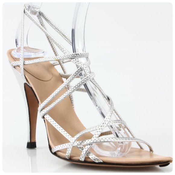 """⭐️Auth Gucci Stretchy Silver Strappy Heels 7.5 Authentic Gucci Stretchy Strappy Sandals. Length 10"""", Insole Width 3"""" Heel Height 4.75""""  Slight signs of wear on toe and back of heels. Insole otherwise clean and I had the heel tips recently replaced by a very expensive cobbler so they should last a long time. Great for a night out with the girlfriends or a romantic date. Priced to sell. Retail price $895. Gucci Shoes Sandals"""