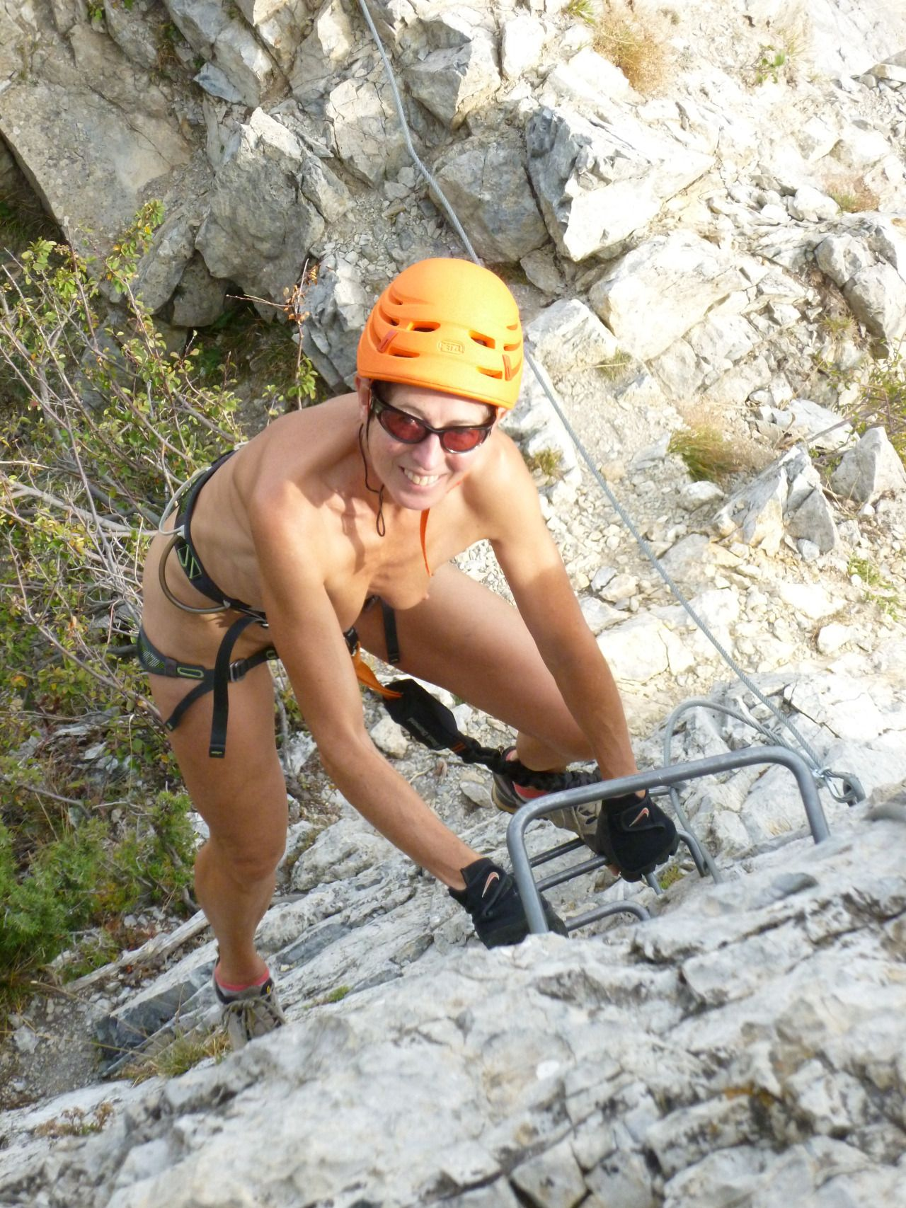 nude women climbing mountain