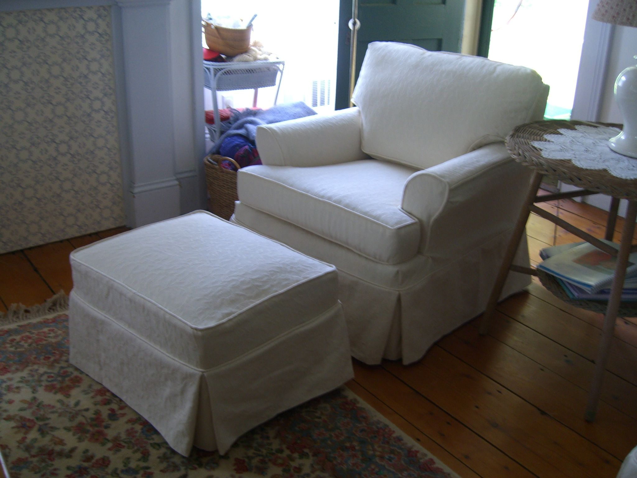 Club chair and ottoman in crisp white fabric slipcovers