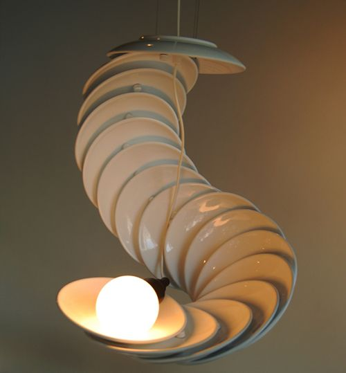 LOVE the snaking form on this #lamp made from #plates.