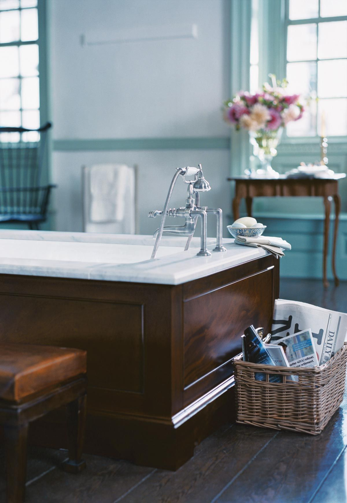 Michael S. Smith cast iron bathtub with deck-mounted bath set with ...