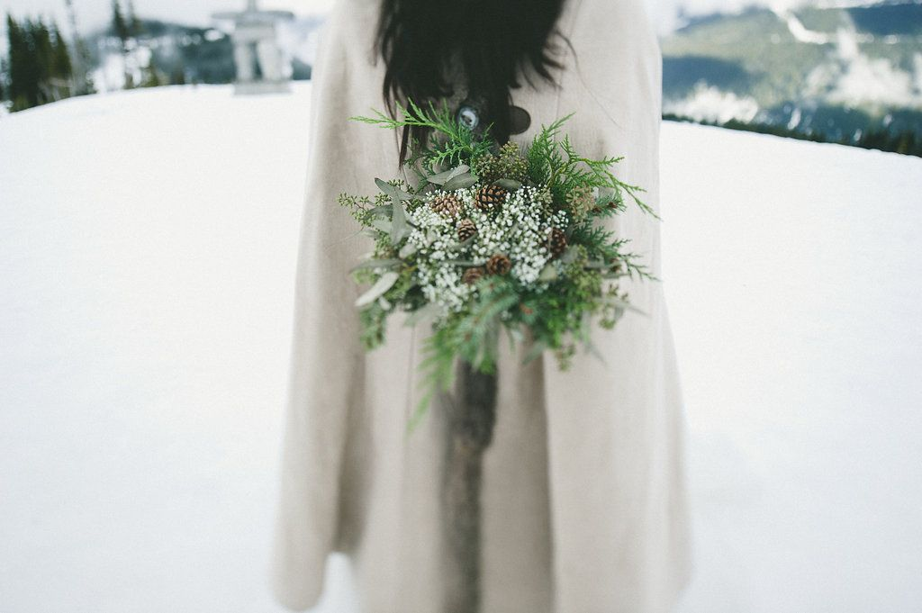 close up of winter wedding flowers photograph by Whistler Wedding Collective