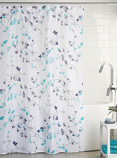 A piece in this season's decorative trend of rustic elegance, with a pattern featuring little twigs and painterly wildflowers in turquoise and purple accents against a pure white background.