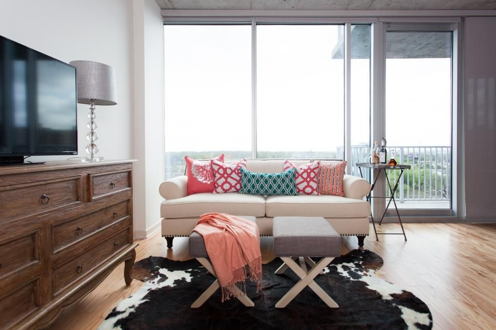A cowhide rug strikes a rustic note in this eclectic living room ...