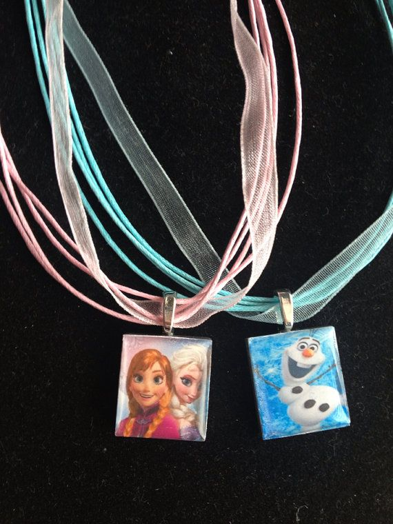 Disneys newest movie: Frozen inspired.... Necklace This pendant is made with a wooden scrabble tile.    The backs and sides are PAINTED