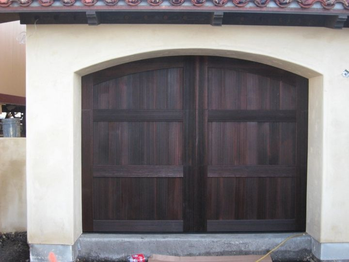 Picture 2: 9x7 Ranch House stain-grade cedar garage door. Carriage house style with arch built to match the garage opening.