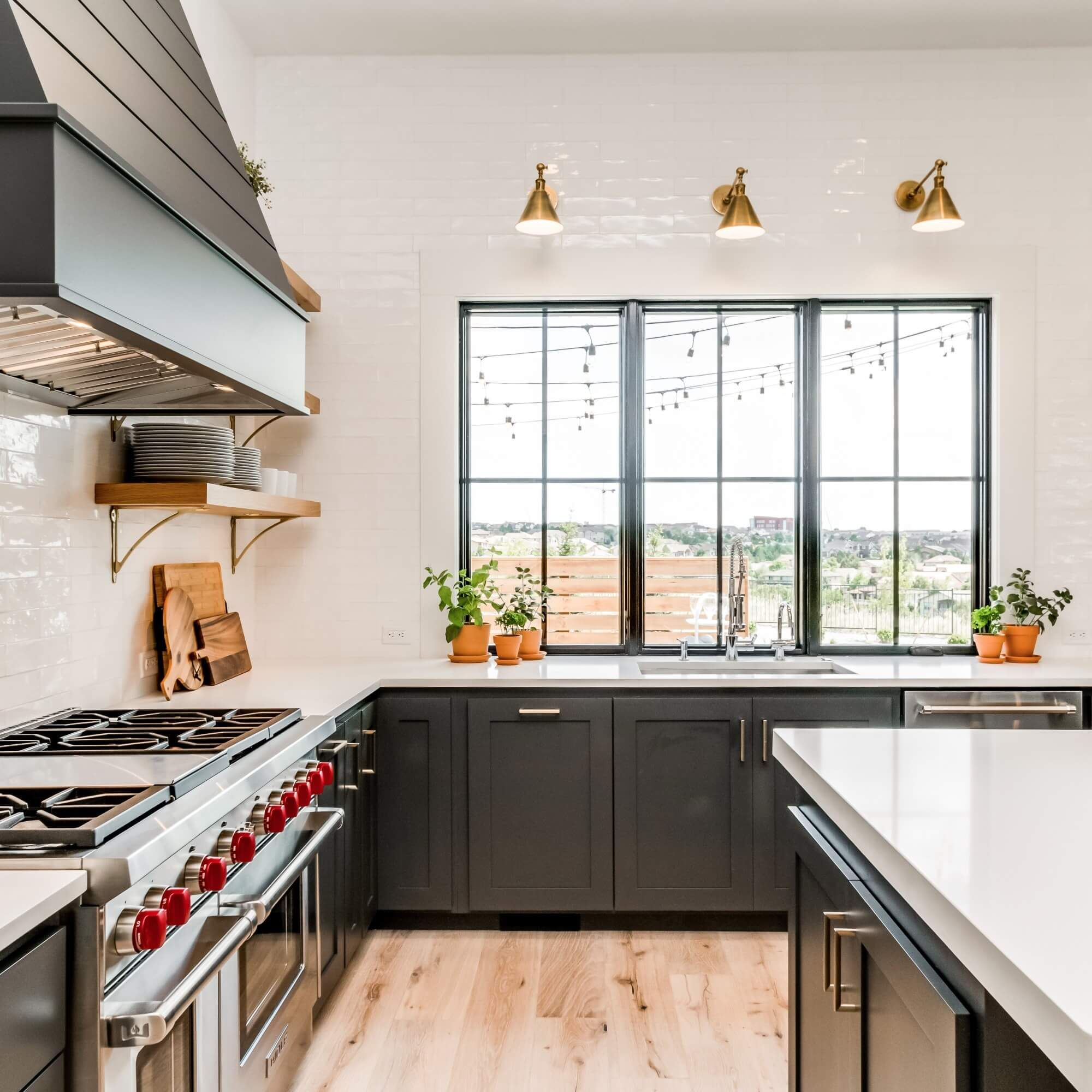 The Small Accents Added To This Kitchen Make It Seem Like A Space With Life Which Is Great For Staging Home Kitchens Kitchen Range Hood Kitchen Interior