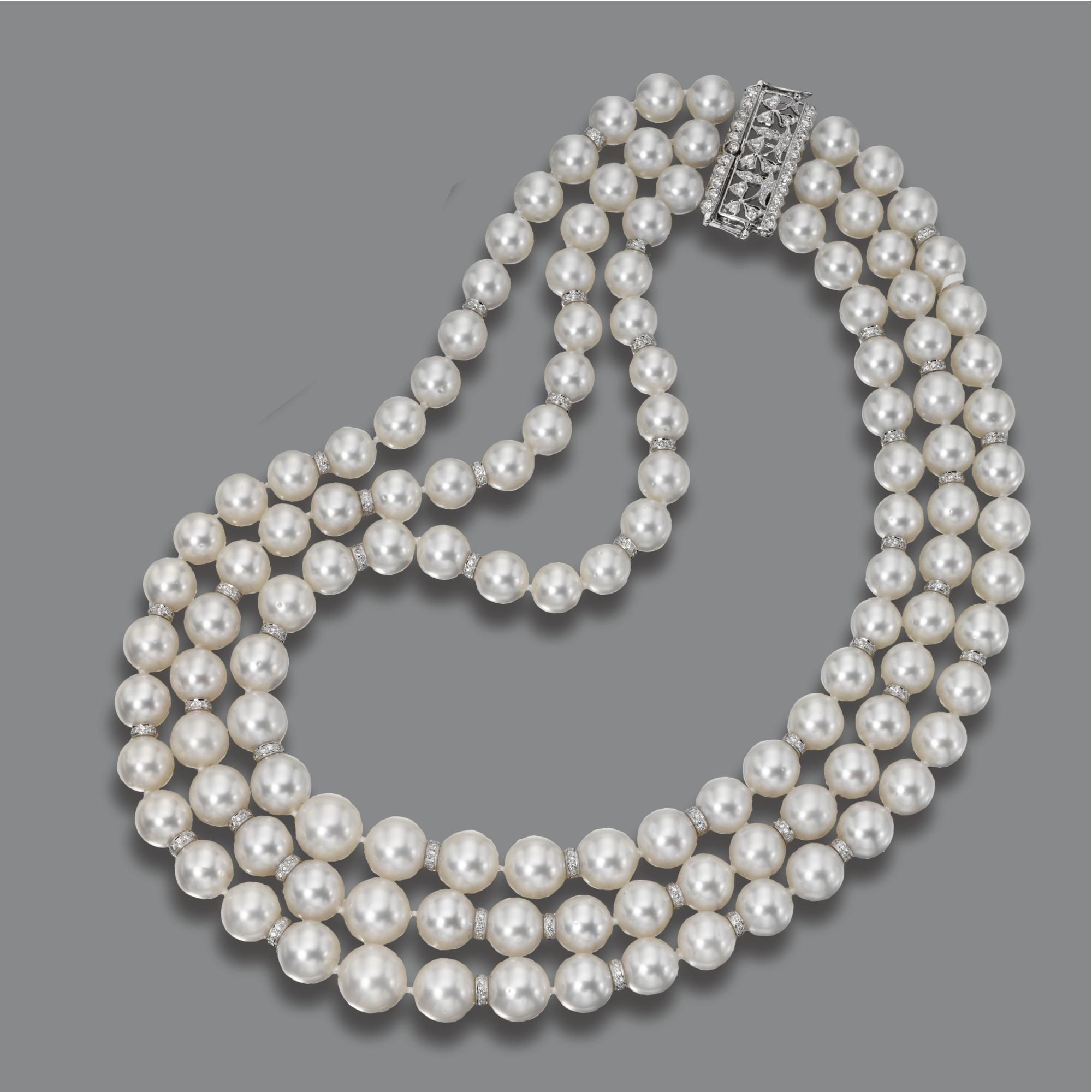 TRIPLE-STRAND CULTURED PEARL AND DIAMOND NECKLACE The slightly graduated rows strung with cultured pearls measuring approximately 9.1 to 12.6 mm., spaced by rondelles set with round diamonds, the openwork rectangular clasp also set with small round diamonds, altogether weighing approximately 4.30 carats, mounted in 18 karat white gold, length approximately 16 to 19½ inches.