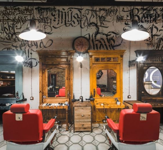 Pops of color and armoire pieces as mirrors make a one-of-kind barbershop.