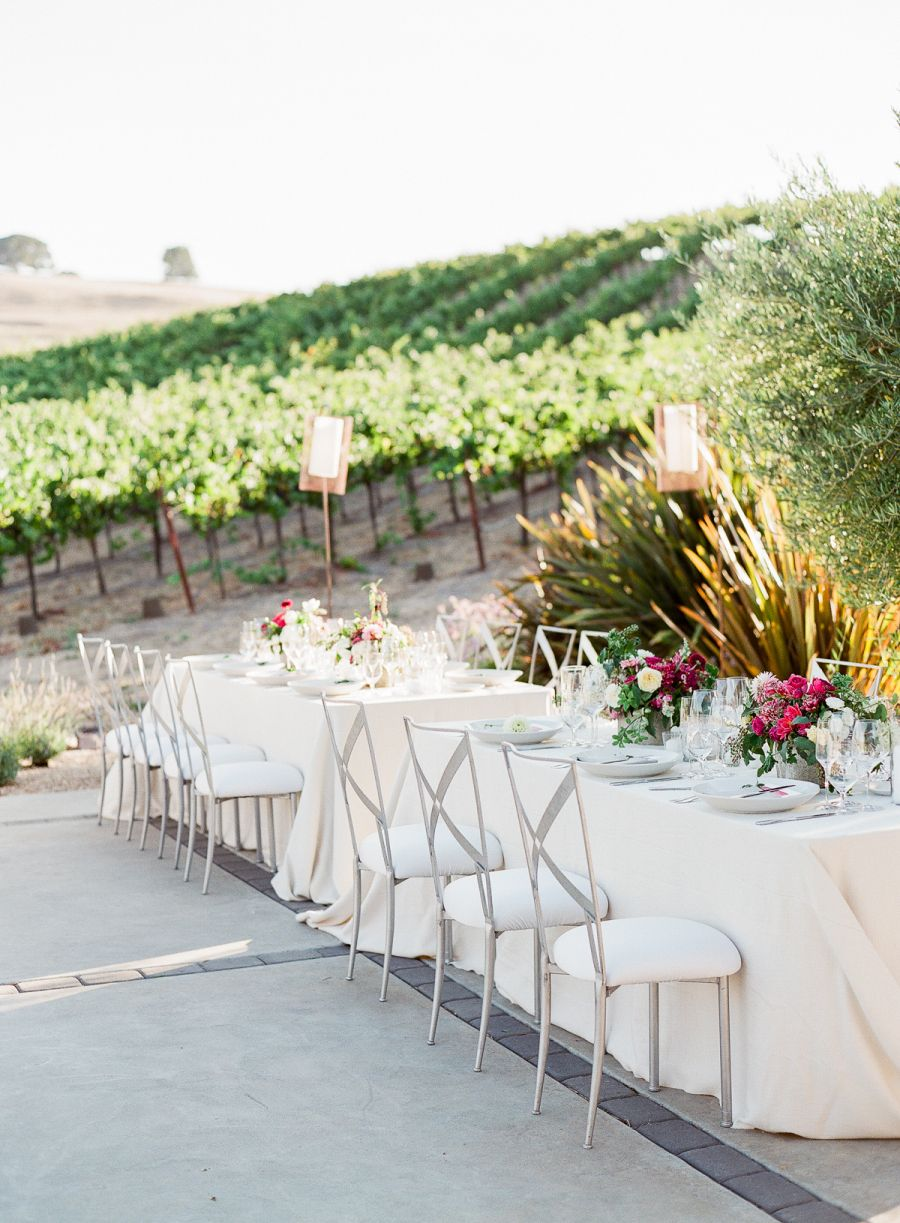 Chic wine country wedding with pops of pink floral designs