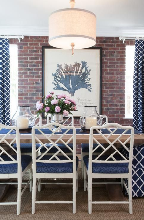 Blue Dining Room Features A Linen Drum Pendant Hanging Over Salvaged Wood Table Lined With White Bamboo Chairs Accented Cushions