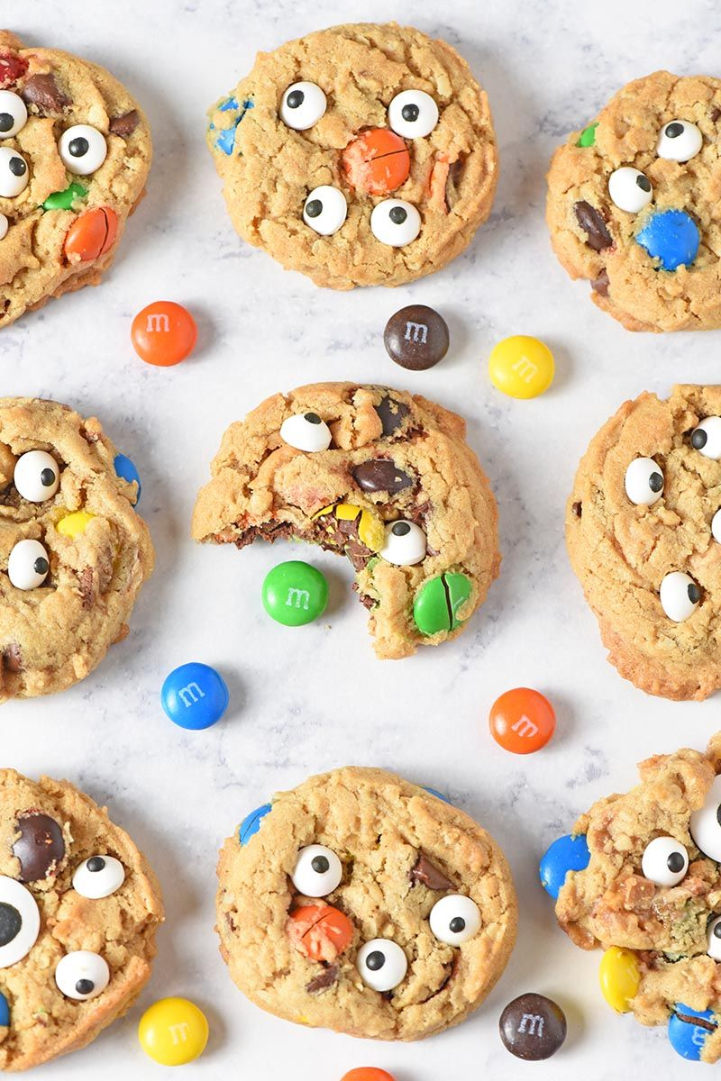 How to make the best chewy monster cookies. Easy to make. Decorated with M&Ms, chocolate, and candy eyeballs. Fun, festive Halloween cookie for kids!