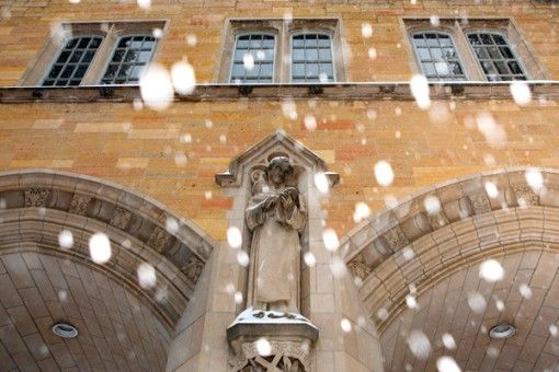 The Arches and a statue of St. Thomas Aquinas amidst falling snow