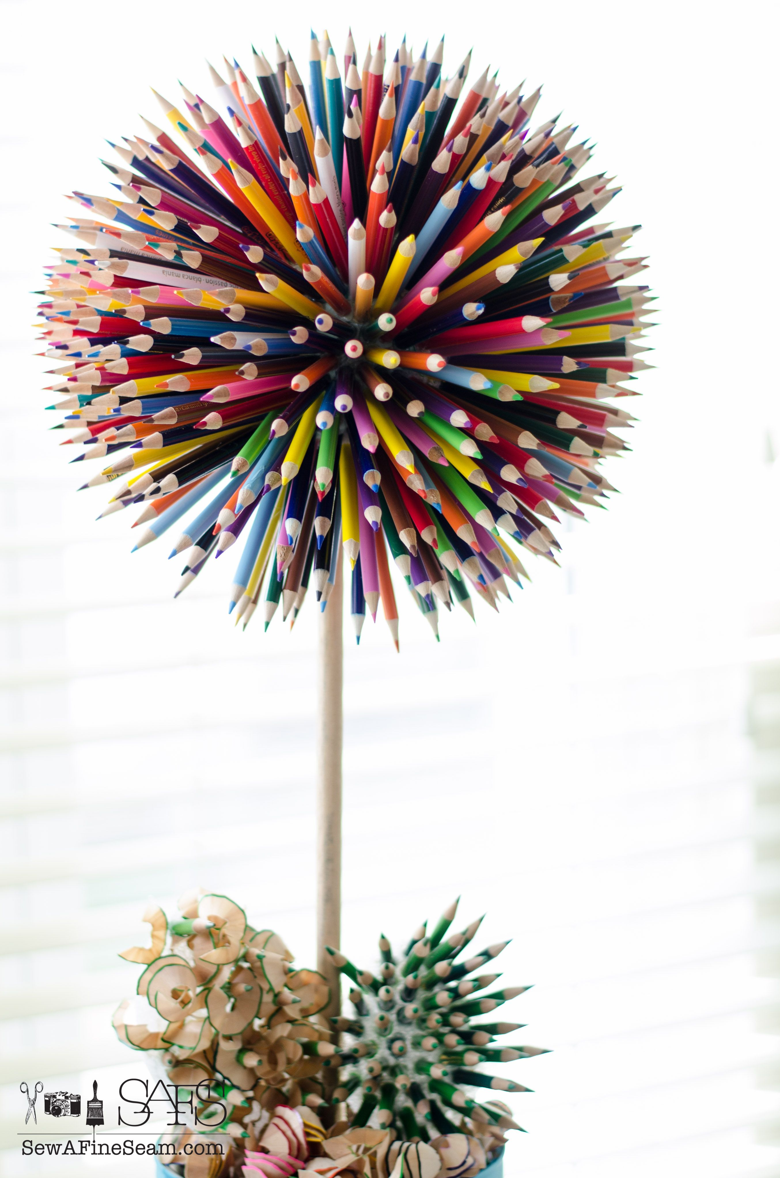 Colored pencil craft flower in a paint bucket flower