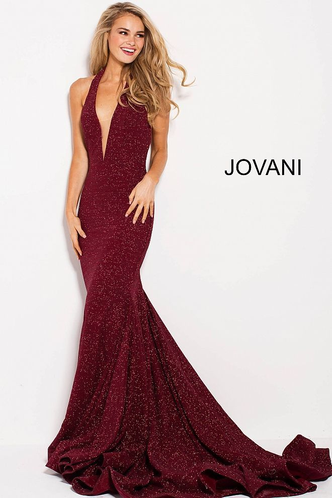 0967bba0 This Jovani 55414 wine red prom gown flaunts a slim-flared silhouette in  stretch glitter fabric, featuring a plunging halter neckline with a modesty  insert.