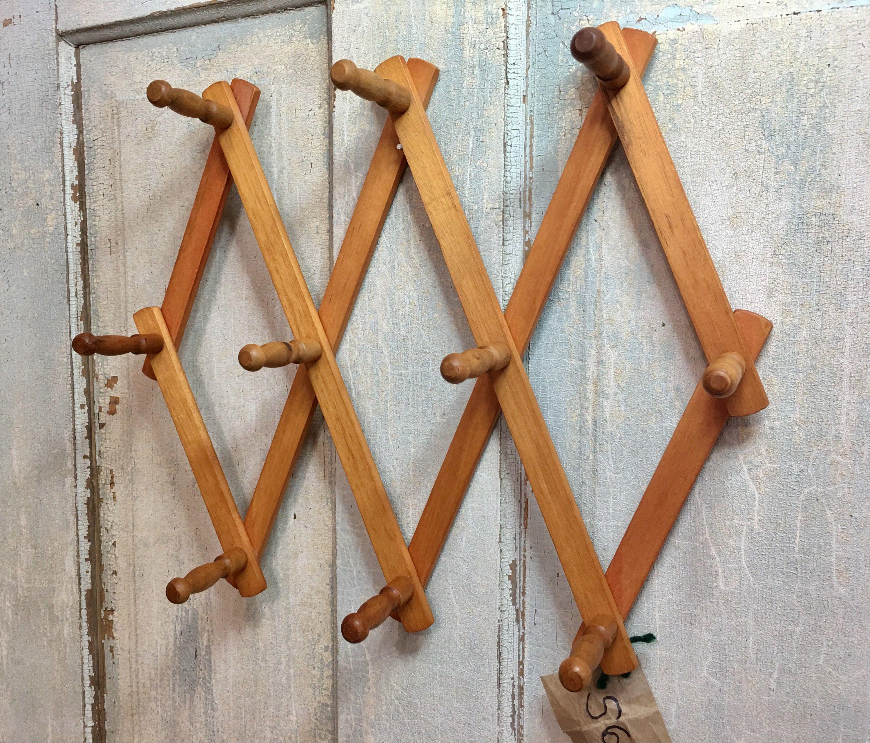vintage wooden accordion wall peg rack