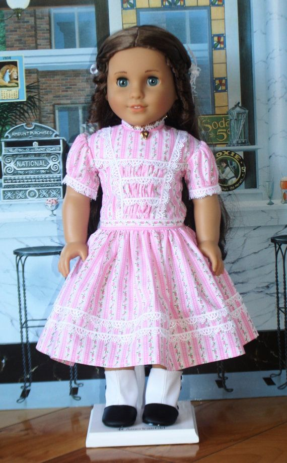 A fresh looking pink stripe floral fabric is used to make this 1860s era dress. The pattern is from Heritage Doll Fashions. The bodice front #dressesfromthesouthernbelleera