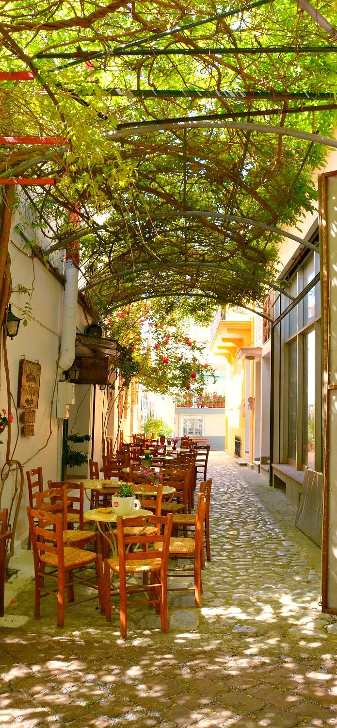 An shady outdoor cafe in Agiassos village on