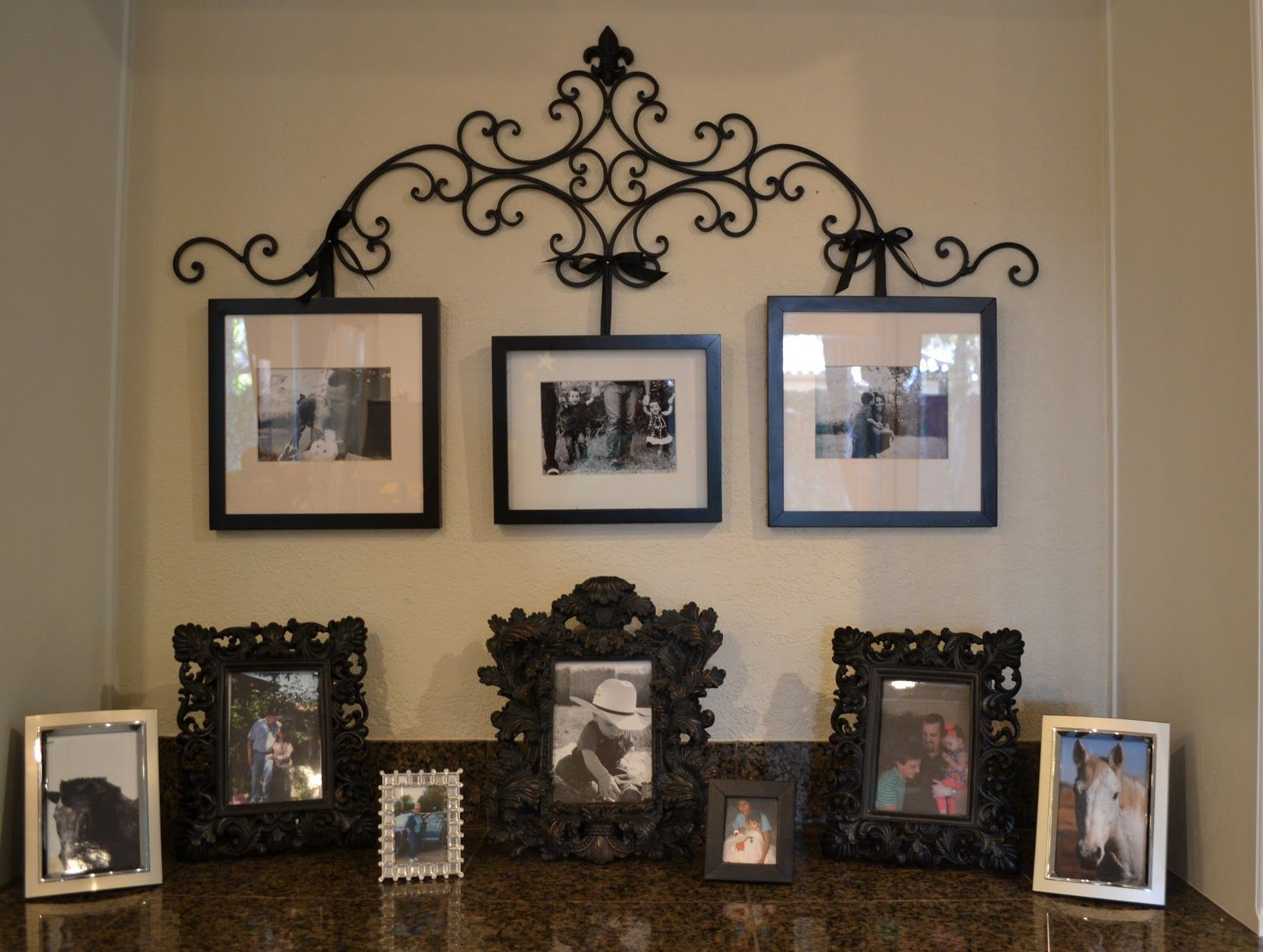 Diy Wrought Iron Picture Hanger With Upcycled Frames Iron Decor