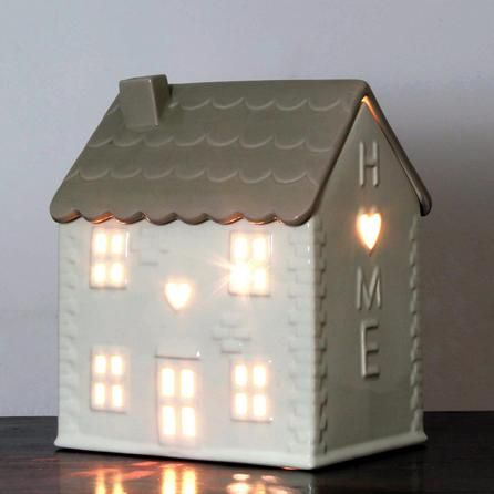 This novelty table lamp provides elegant illumination through its this novelty table lamp provides elegant illumination through its windows and doors aloadofball