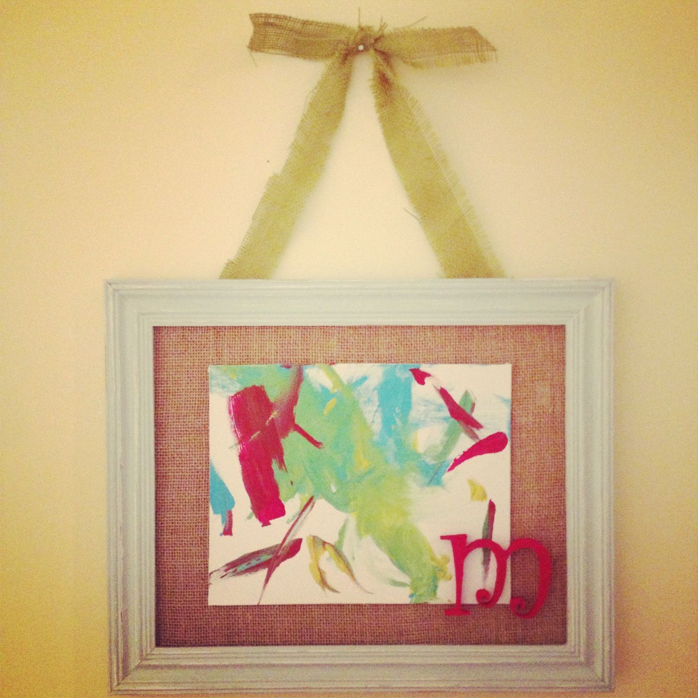Molly's first artwork framed and hanging in the playroom