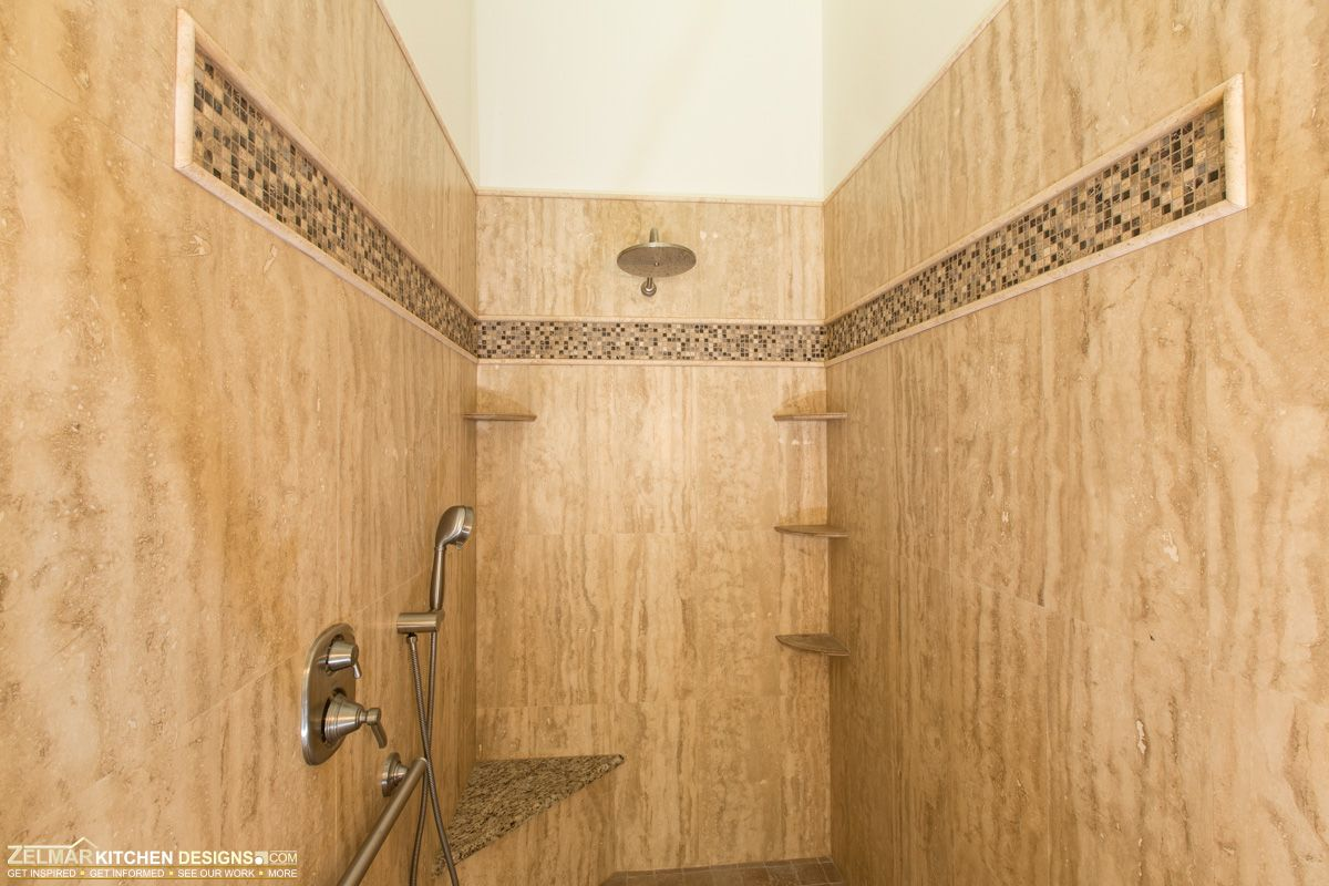 Vein cut travertine shower walls. Visit https://www ...