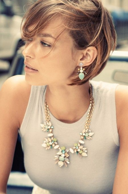 Short hairstyle and statement necklace.