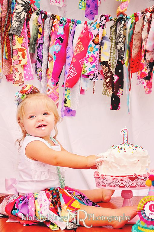 Baby girl's first birthday smash cake session. Rag garland and rag tutu // by Mandy Ringe Photography