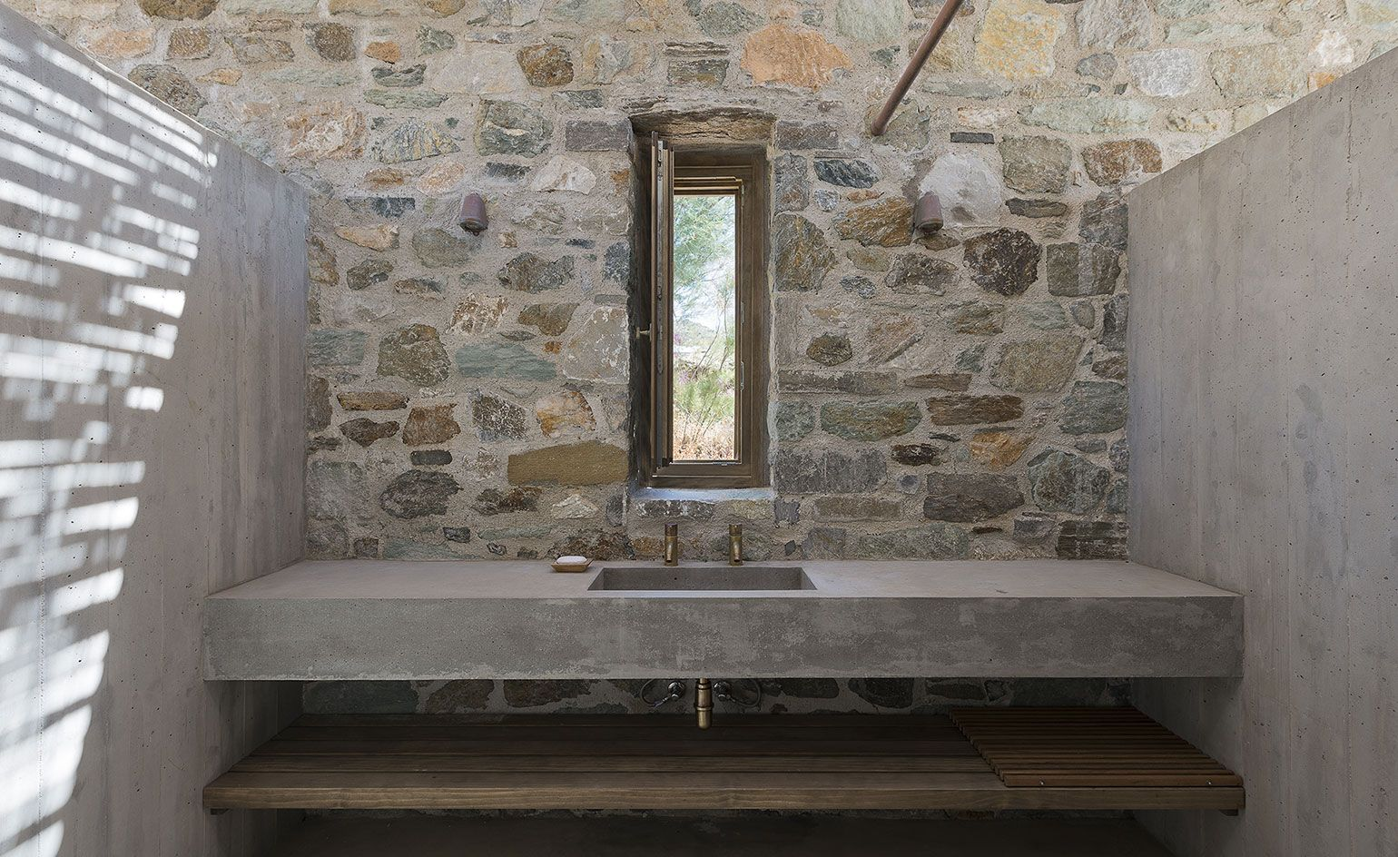 Divine Simplicity Stone Clad Syros Island House Is Orientated To Perfection Bathroom Inspiration Modern Bathroom Design Inspiration Bathroom Accessories Design