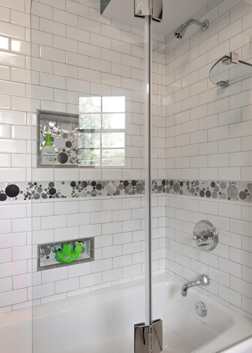 For this kid\'s bathroom, classic white subway tile is used ...