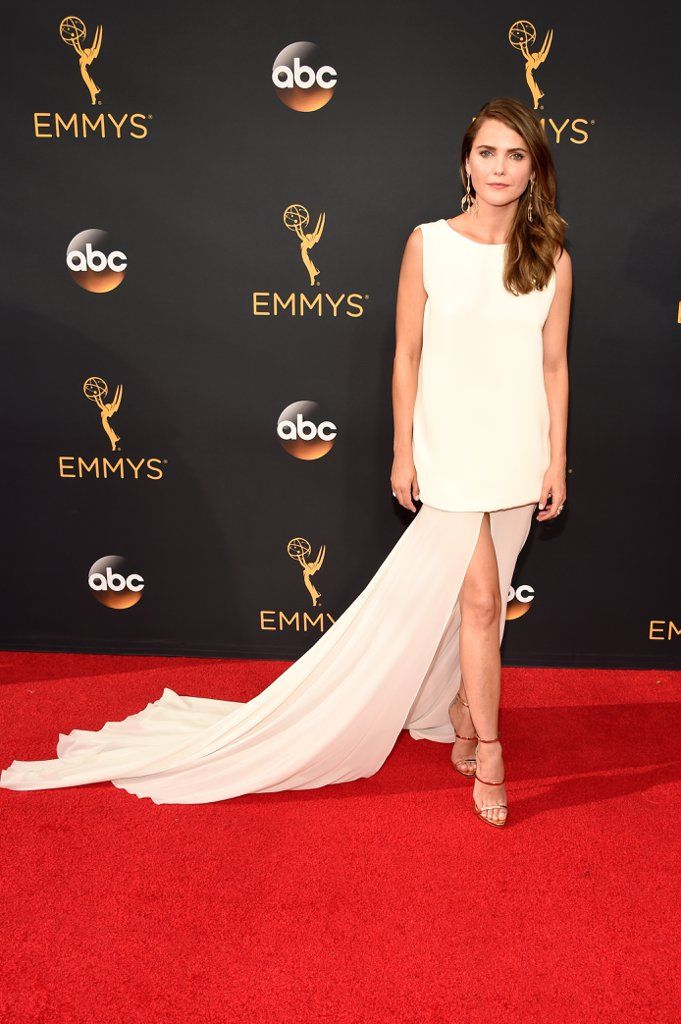 Wearing a cream dress with a floor-sweeping train and Giuseppe Zanotti shoes. Image Source: Getty / Kevin M...