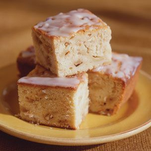 Spiced Apple Coffee Cake. Tangy cream cheese in the cake base with chunks of apple and a sweet glaze to finish.