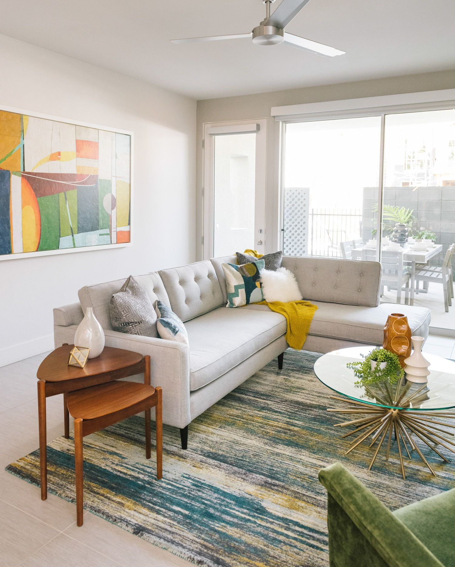 West Elm S Colorful Verve Rug And Starburst Coffee Table Give This