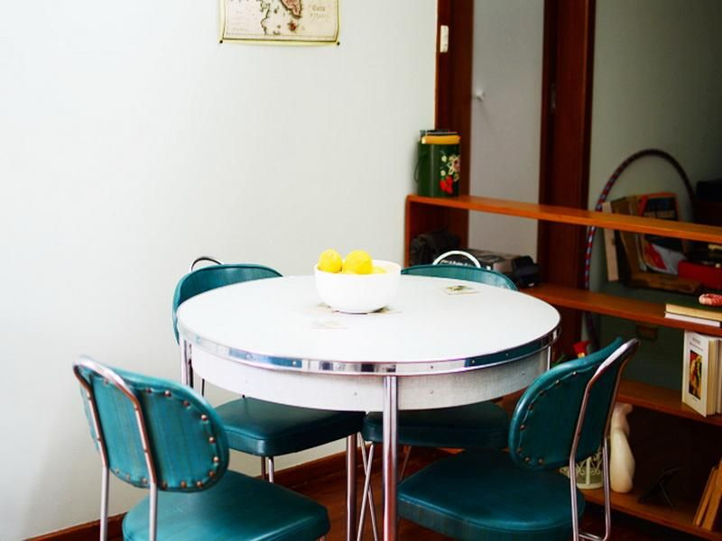 Small Retro Style With 1950s Round White Dining Table And Green Chairs