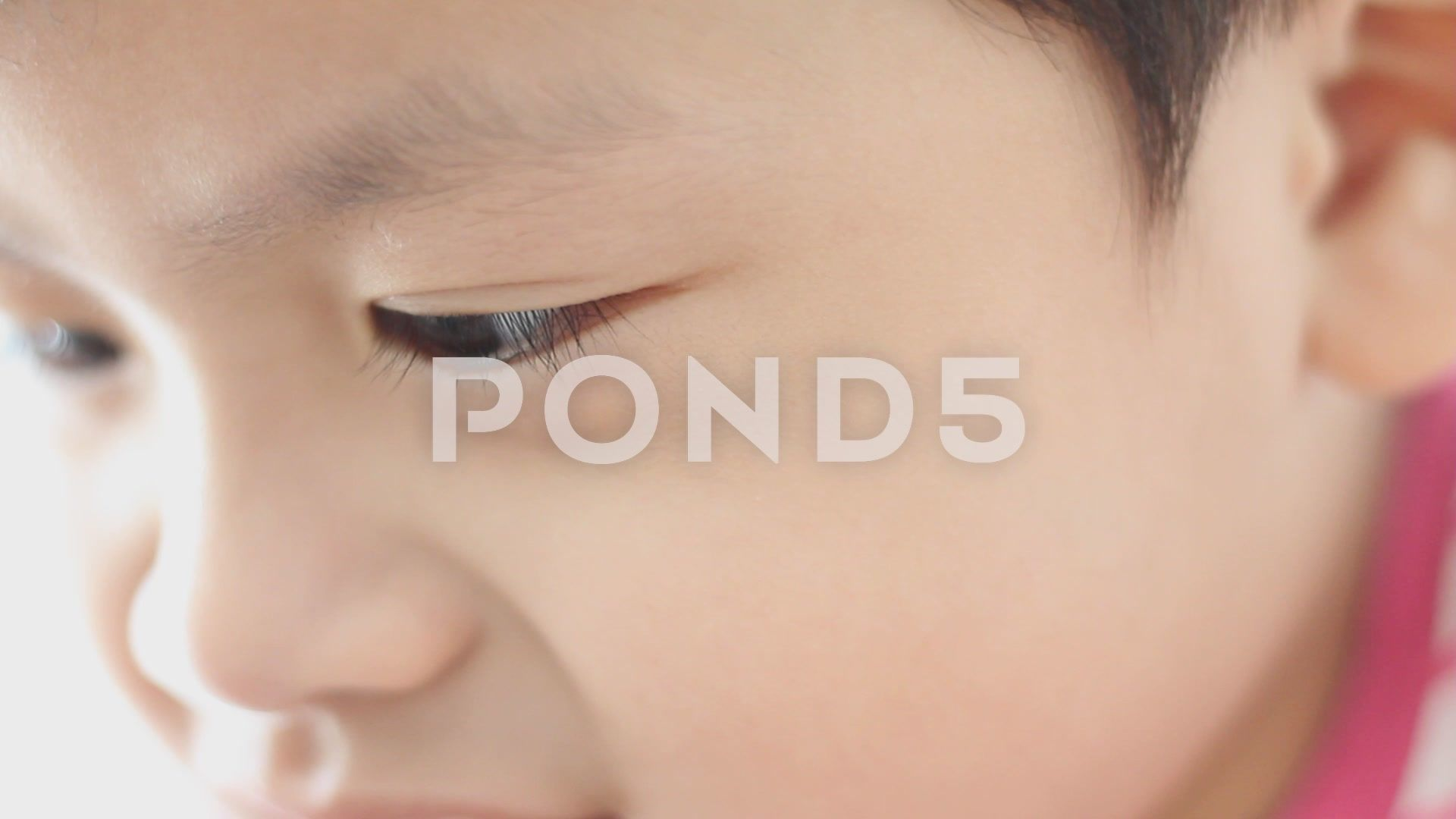Close up eye little boy at looking mobile Stock Footage boy eye