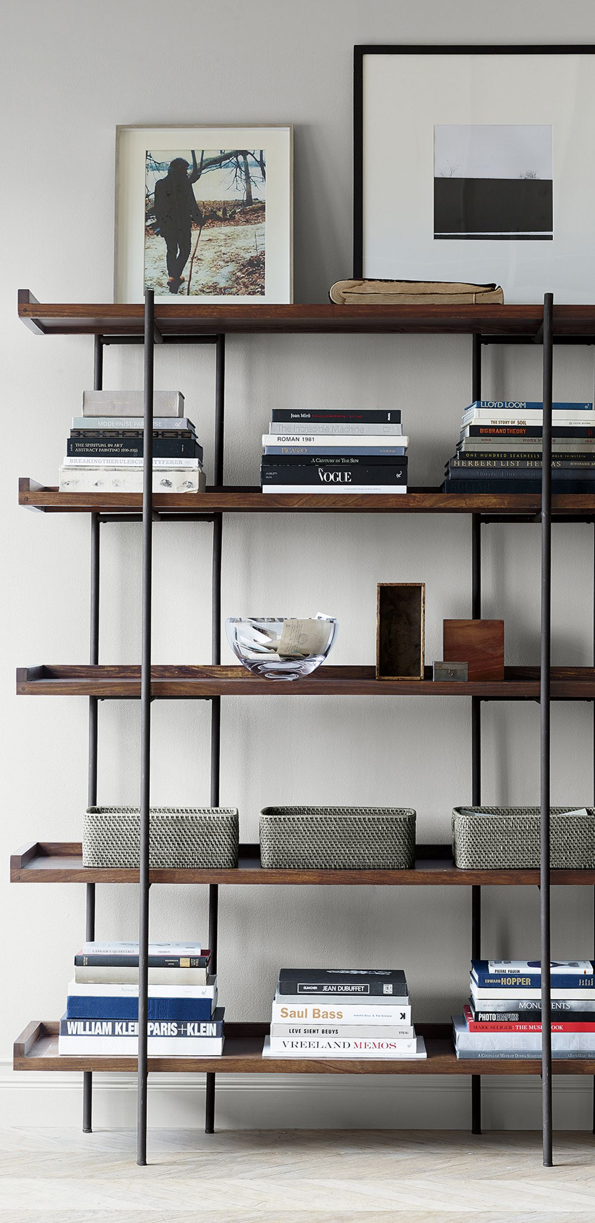 Expansive shelving anchors family room office or