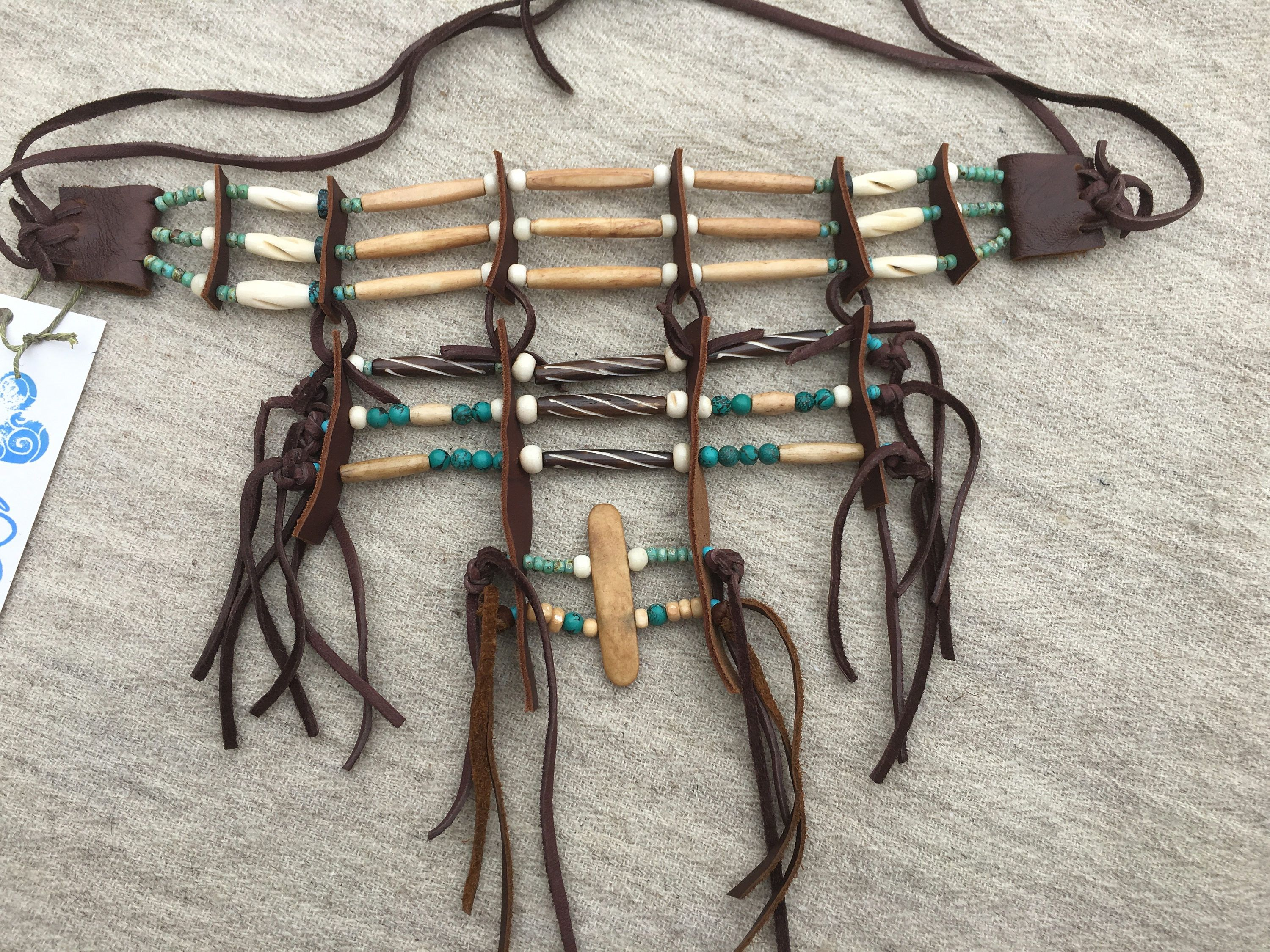 stone necklace hammered breastplate copper pin and long fringes turquoise