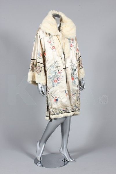 An embroidered ivory satin evening coat, Chinese for the European market, 1920s, the ivory satin ground embroidered with floral sprays, the borders with delicately worked figures, lined in white rabbit fur