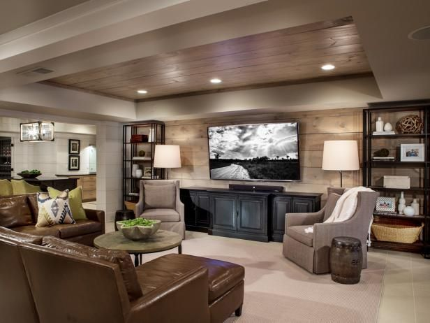 See This Sleek Transitional Living Room With A Rustic Wood Tray Ceiling On Hgtv Com Rec Room Basement Basement Remodeling Basement Makeover