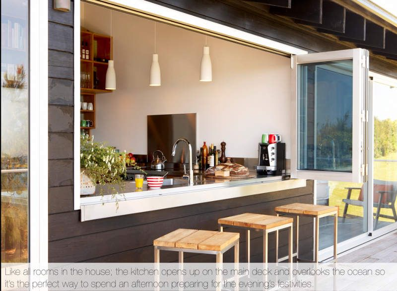 The windows from the kitchen open out completely to allow for Kitchen window bar ideas