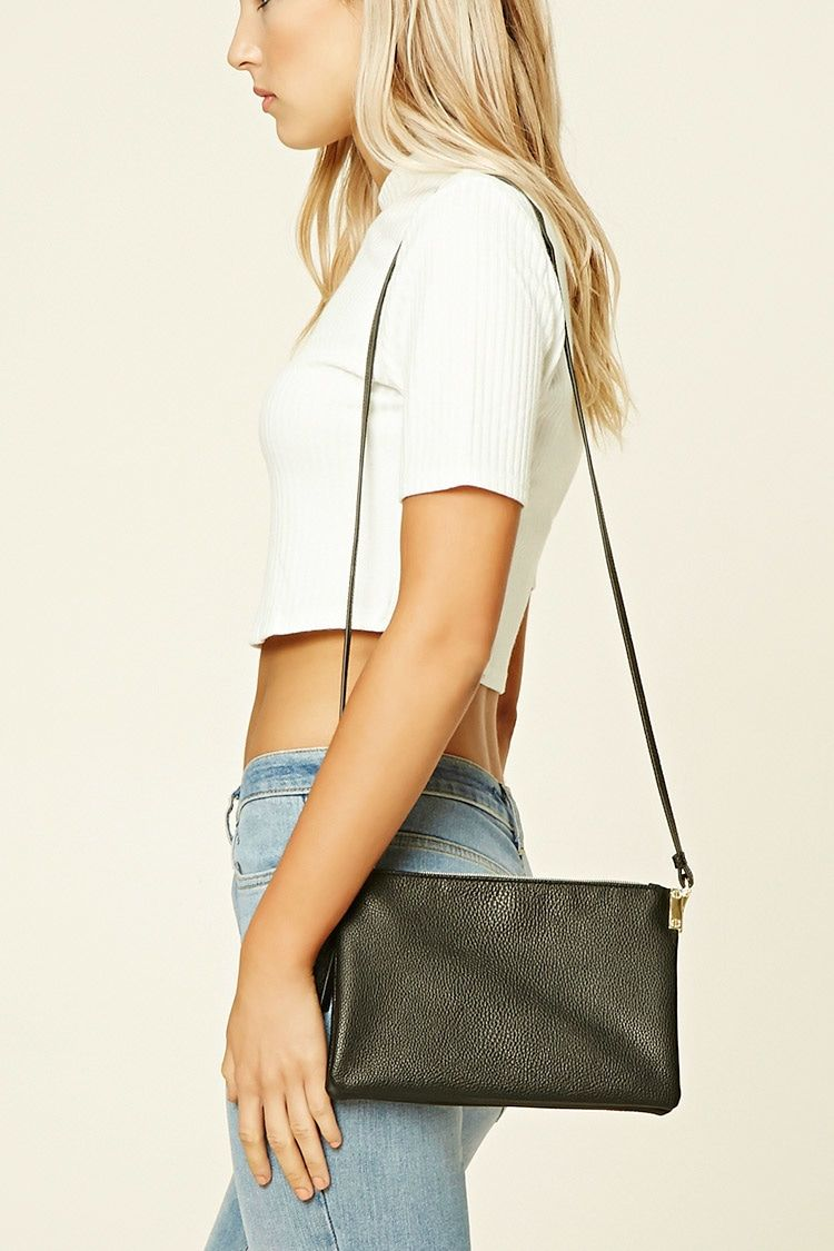 A pebbled faux leather crossbody featuring a shoulder strap, high-polish zipper closure, and an interior zip pocket.