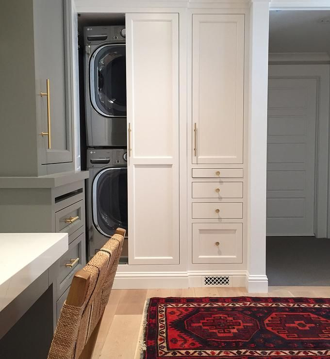 Beautiful Laundry Room Features Hidden Stacked Washer And Dryer Concealed  Behind Bi Fold Cabinet Doors Across From A Gray Built In Desk Flanked By  Tall Gray ...